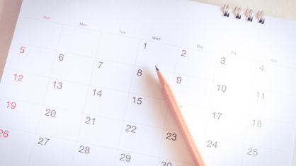 Kalenderseite mit Stift